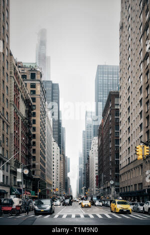 New York City street and buildings, Sixth Avenue, New York, USA - Stock Image