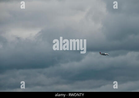 airplane of CSA, Czech Airline landing  in a stormy day - Stock Image