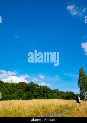 London, England. 7th July 2018. A young woman enjoying a walk on Harrow-on-the Hill in the afternoon sunshine. The present heatwave is set to continue. ©Tim Ring/Alamy Live News - Stock Image