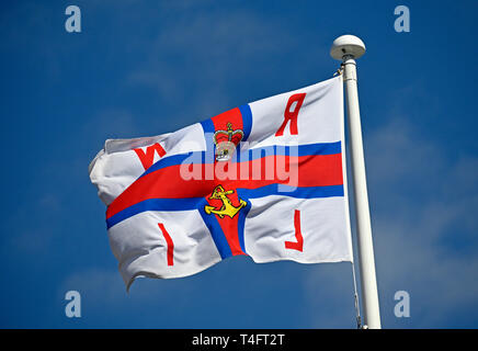 R.N.L.I. flag flying at the Royal National Lifeboat Institution Station. Marine Drive Central, Morecambe, Lancashire, England, United Kingdom, Europe. - Stock Image