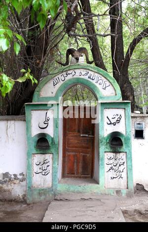 Door entrance of a house of worship in Langar, GBAO province, Tajikistan - Stock Image