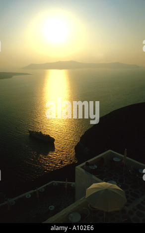 Sunset and coast off Thira Santorini Greece - Stock Image