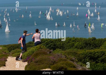 fleet,people,watching,spectators,The Needles,Alum Bay,Headen Warren, spectators,Round the Island Race,Cowes,Isle of Wight,England, 29 June, 2019, - Stock Image