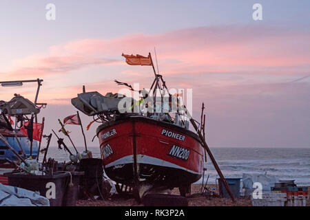 Hastings, East Sussex, UK. 9th February 2019. Fishing boat at dawn on the Stade Fishing Boat beach, on a mild blustery day. Carolyn Clarke/Alamy Live News - Stock Image