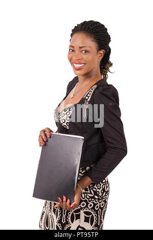 Young business woman smiling standing holding a folder black isolated on white background - Stock Image