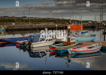 Boats in Wick harbour - Stock Image