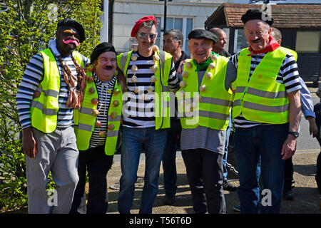 A team of French men with onions in the annual Good Friday Marbles Competition in fancy dress in Battle Market Square, Battle, East Sussex, UK - Stock Image