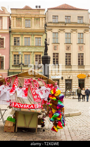 Market stall selling souvenirs and Polish scarfs in the old market square in the Polish city of Poznan Poland - Stock Image