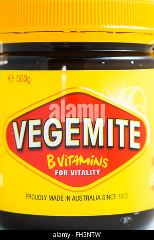 Vegemite is a dark brown Australian food paste made from brewers' yeast extract with various vegetable and spice - Stock Image
