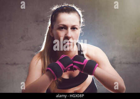 Portrait of a sexy fitness woman ready to fight. - Stock Image