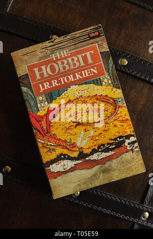 A vintage 1984 paperback edition of The Hobbit written by J.R.R. Tolkien in 1937 and published by Unwin Books - Stock Image