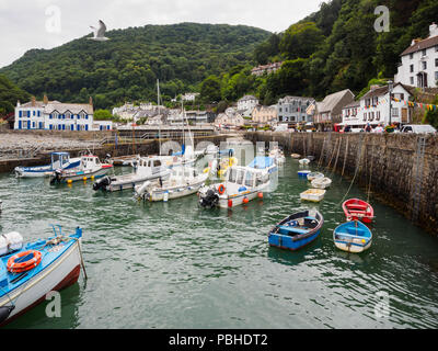 Mix of fishing and pleasure craft in the small harbour at Lynmouth, Devon, UK - Stock Image