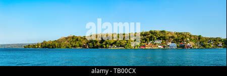 View of San Miguel Village across Lake Peten Itza, Guatemala - Stock Image