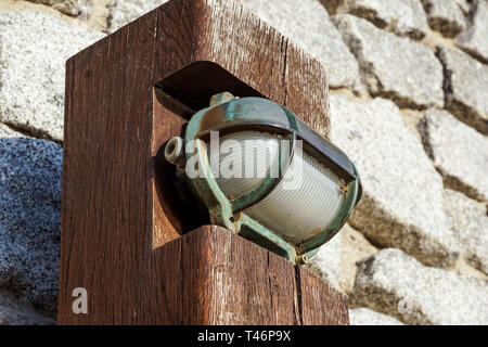 small wooden pedestrian lamp post View along the wooden boardwalk - Stock Image