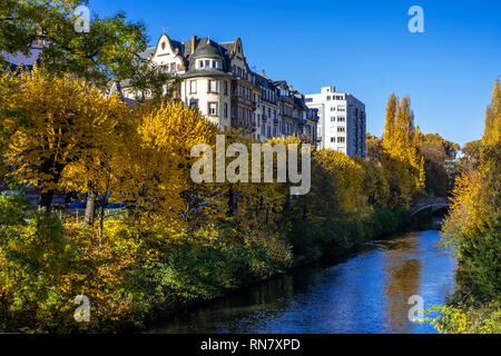 Strasbourg, Alsace, France, Aar river, trees with autumn foliage, residential buildings, Neustadt district, - Stock Image