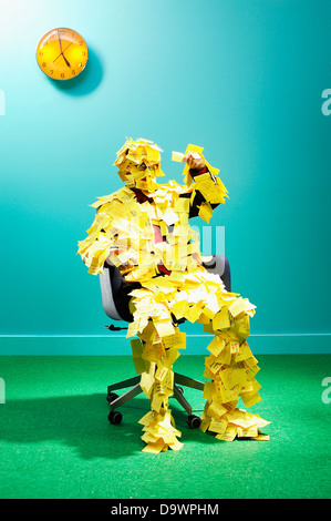 man cover of post its - Stock Image