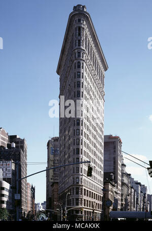 The Flatiron Building, originally the Fuller Building, is located at 175 Fifth Avenue in the borough of Manhattan, New York City, and is considered to be a groundbreaking skyscraper. Upon completion in 1902, it was one of the tallest buildings in the city and one of only two skyscrapers north of 14th Street ? the other being the Metropolitan Life Insurance Company Tower, one block east. The building sits on a triangular island-block formed by Fifth Avenue, Broadway and East 22nd Street, with 23rd Street grazing the triangle's northern (uptown) peak. As with numerous other wedge-shaped building - Stock Image