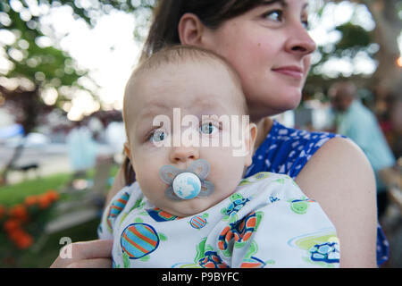 A baby with a pacifier. - Stock Image