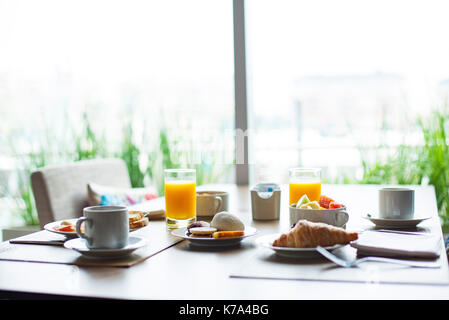 Breakfast on cafe table - Stock Image