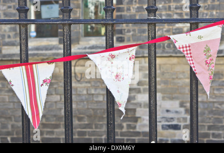 Vintage bunting on metal railings at a country fair - Stock Image