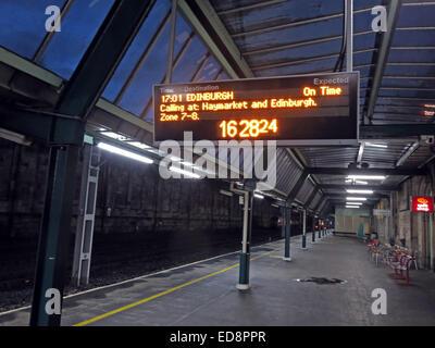 Empty Platform at Carlisle Station, Cumbria at dusk, next Virgin train to Edinburgh - Stock Image