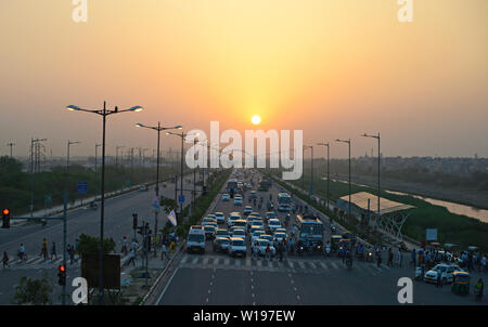 sunset with traffic on Highway at New Delhi,India - Stock Image