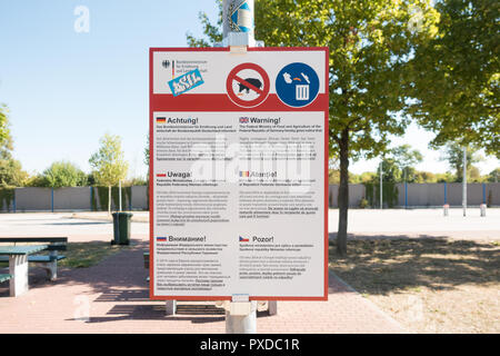 African Swine Fever information and warning sign next to rubblish bins in Germany, Europe - Stock Image
