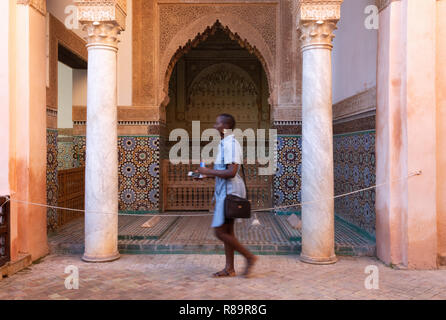 A tourist looking at the Saadian Tombs, Marrakech Morocco North Africa - Stock Image