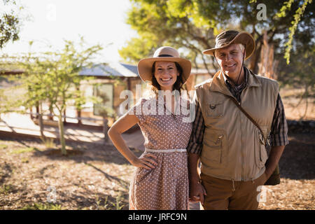 Senior couple standing at the resort - Stock Image