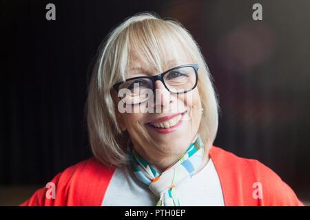Portrait smiling, confident senior woman - Stock Image