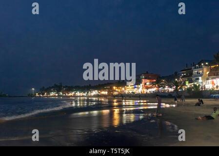Horizontal view of Lighthouse beach in Kovalam Kerala at night, India. - Stock Image