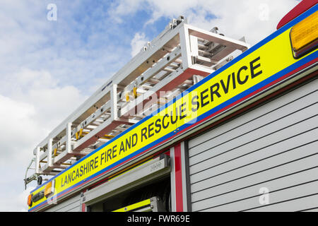 Lancashire Fire and Rescue legend on bright yellow backing on the side of a fire engine. - Stock Image