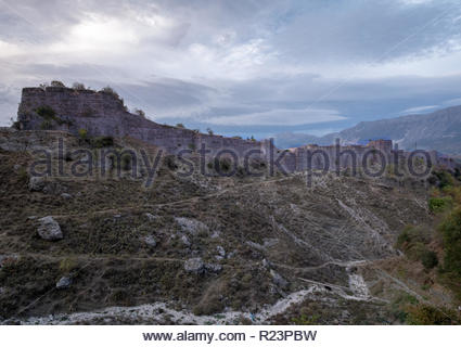 View of the fortress in Gjirokaster Albania, with mountains in background on a stormy cloudy day. - Stock Image