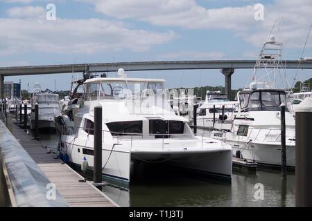 A luxury catamaran moored at The Wharf in Orange Beach, Alabama, USA. - Stock Image