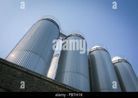 Steel storage containers outside the Guinness brewery in Dublin, Ireland, Europe. - Stock Image