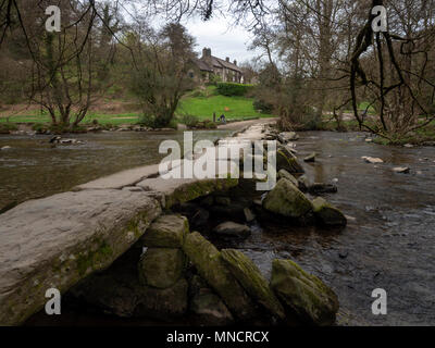 Tarr Steps over the River Barle, with Tarr Farm Inn in the background, near Dulverton, in Exmoor National Park, UK - Stock Image