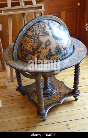 A globe drinks cabinet inside Hylands House, Writtle, Chelmsford, Essex, UK - Stock Image