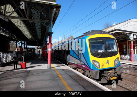 A TransPennine Express train at Platform 2 at Oxenholme station in the Lake District, Cumbria, northern England - Stock Image