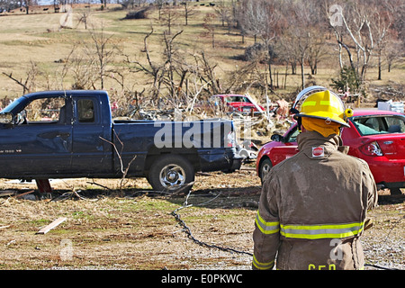Fireman Surveying Tornado Damage. - Stock Image