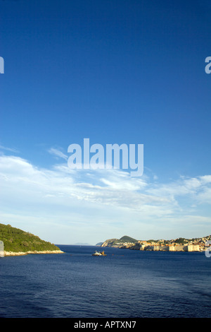 Approaching Dubrovnik from the sea, Dubrovnik city walls and the  The Island of Lokrum, Dalmatian Coast, Adriatic Sea, Croatia, - Stock Image