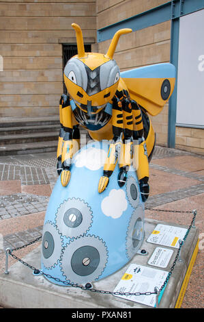 A City Transformed, by Helen Russell Creations.  One of the Bee in the City sculptures, Great Northern Square, Manchester, UK. - Stock Image