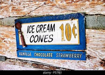 Vintage or antique advertising sign for ice cream cones in three flavors. - Stock Image