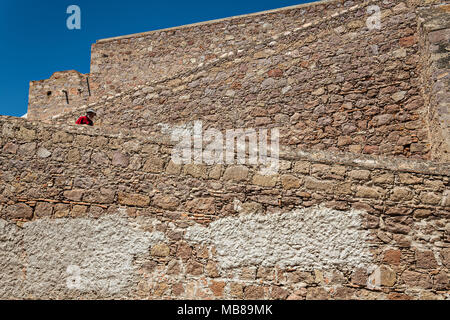 A man walks down the ramp at the old Mescal distillery part of the ruins at the Hacienda de Jaral de Berrio in Jaral de Berrios, Guanajuato, Mexico. The abandoned Jaral de Berrio hacienda was once the largest in Mexico and housed over 6,000 people on the property. - Stock Image