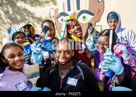 Miami Florida Liberty City Liberty Square public housing Hands On Miami volunteer Martin Luther King Jr. Day of Service MLK stud - Stock Image