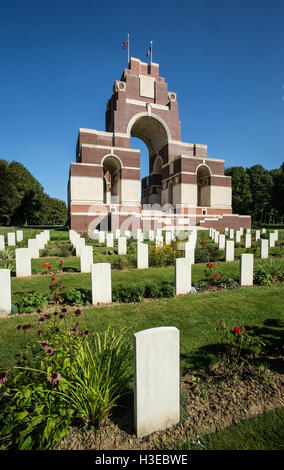 Looking across WWI gravestones towards the commemorative Thiepval Memorial in France designed by the architect Edwin - Stock Image