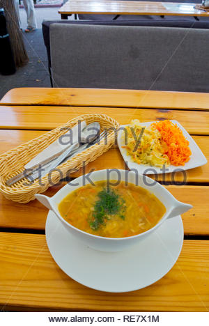 Fish soup and salad, smazalnia fried seafood restaurnt terrace, Molo Poludniowe, South Pier, Gdynia, Poland - Stock Image