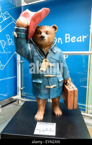 A statue of Paddington Bear at Paddington Station, London, England, UK - Stock Image