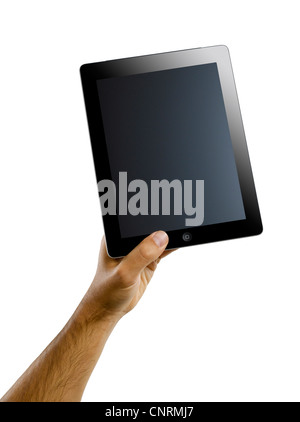 A male hand holding an iPad four - Stock Image