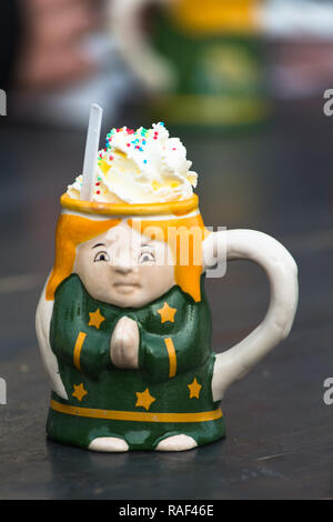 Punsch topped with whipped cream in ceramic mug at Christmas Market at Belvedere Palace, Vienna, Austria. - Stock Image