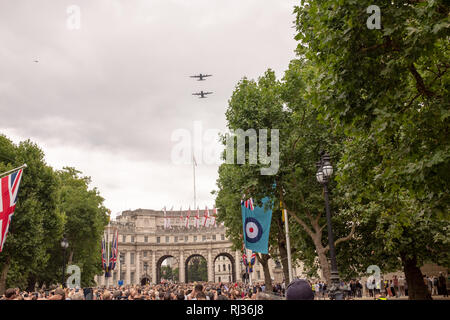 Historic Royal Air Force aircraft fly above The Mall towards Buckingham Palace to commemorate the RAF's centenary in July 2018 - Stock Image